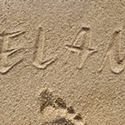 Elan im Sand geschrieben